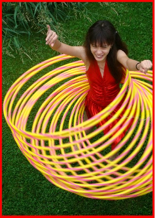 Mabelle spins dozens of Hula Hoops in her World Class Specialty Act for Shows of all kinds!